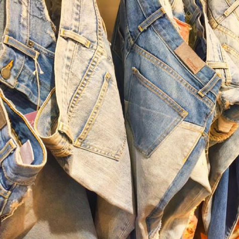 fake vintage denim jeans hanging