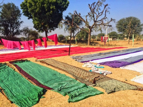 fabric drying on the ground in the sun