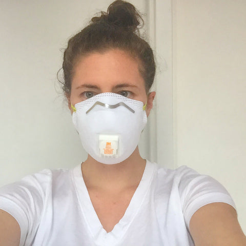 melanie disalvo wearing a dust mask to protect from stray particles of carbon hydroxide