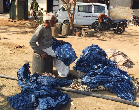 indigo fabric being sorted and inspected