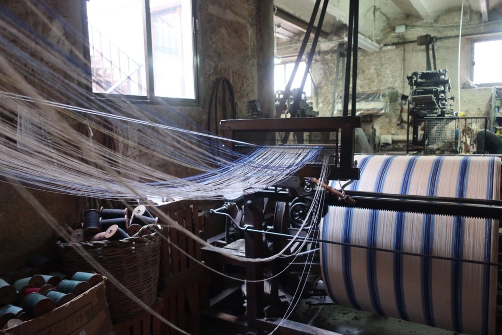 dyed yarns being wound onto a warp beam
