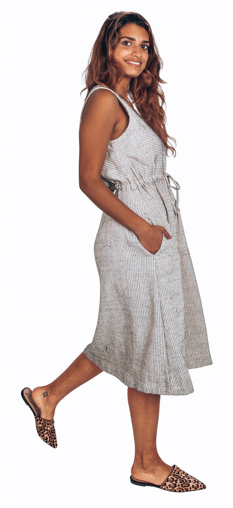white sleeveless dress with black stripe embroidery ethically made