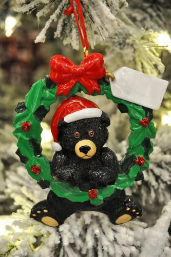 Bear with wreath
