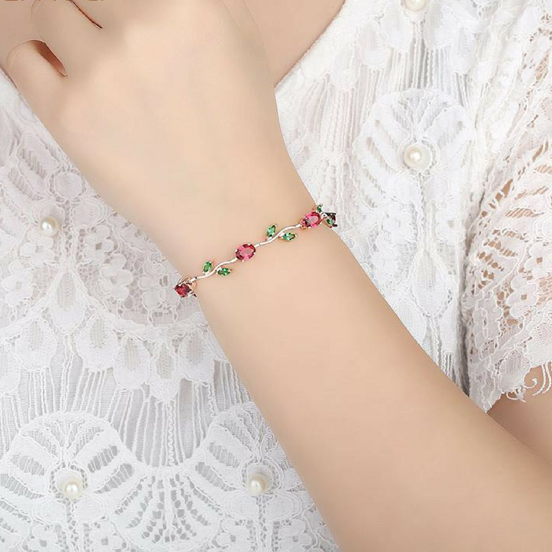 woman wearing trendy cubic zirconia bracelet with colored stones