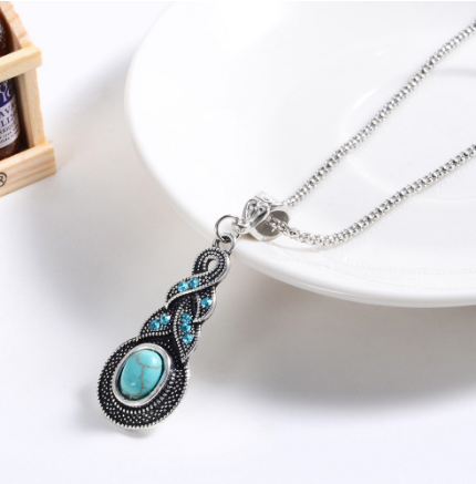 faux turquoise and crystal pendant