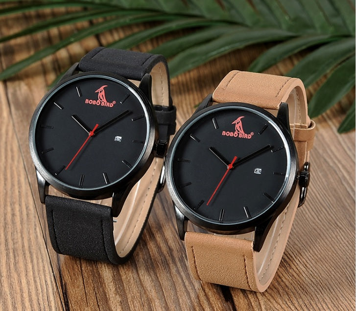 black face watch with red bird on face with black or beige band