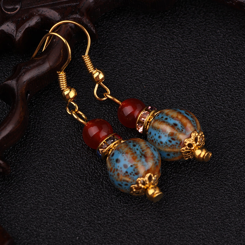 Ethnic gold tone ceramic earrings