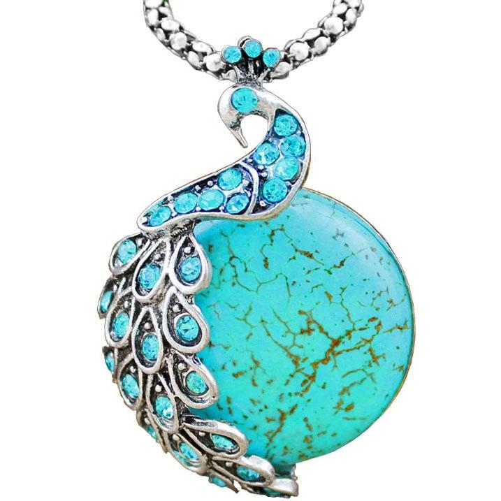 turquoise colored peacock pendant with natural stone and rhinestones