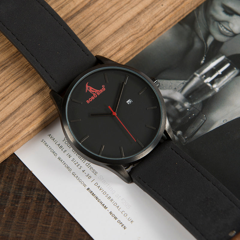 Black faced watch with red bird on face and black band