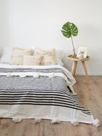Moroccan Pom Pom Blanket - black and white stripes