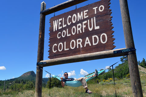 Hammock hanging on Welcome to Colorful Colorado Sign