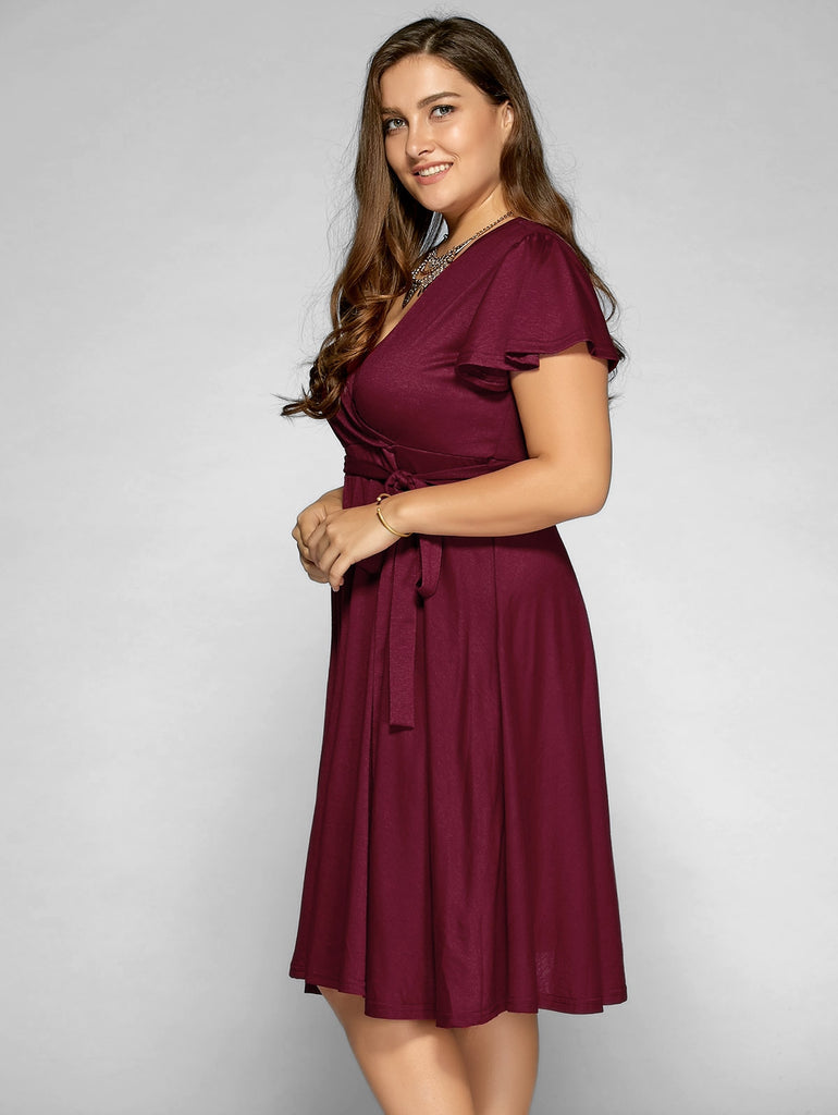 d0452ab0679 Low Cut A Line Plus Size Surplice Front Tie Swing Dress – Zodeys