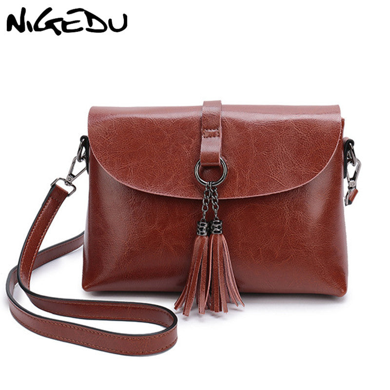 53bbda547073 NIGEDU Genuine Leather Women Messenger Bag with tassel Fashion Small Crossbody  Bag For Girl Simple Design