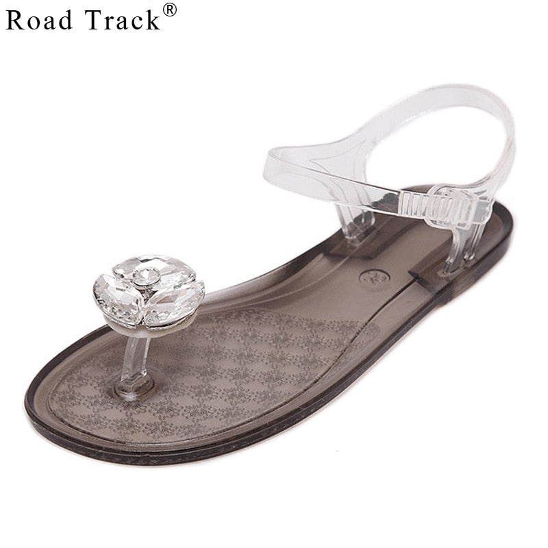 8f1f944efe075 Road Track Jelly Sandals Large Solid Crystal Diamond Flower Flat with Clip  Toe Plastic Tide Platform