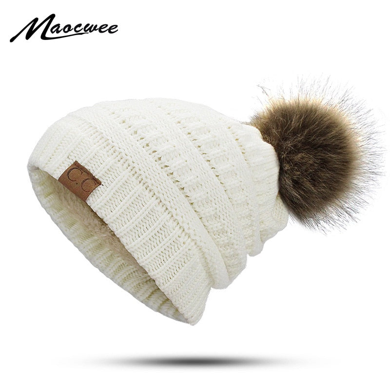 2ccaccccf61 2018 New CC Faux Fur Pom Poms Winter Hat for Women Fashion Solid Warm Hats  Knitted. Hover to zoom ...