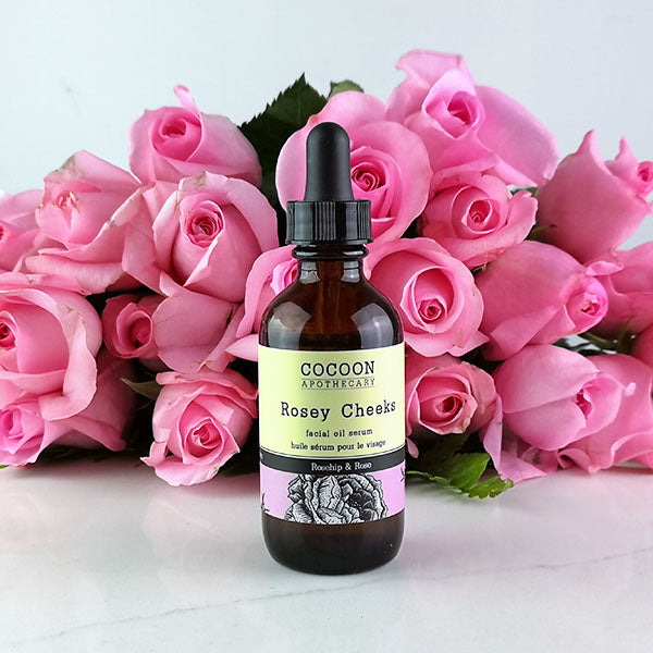 image of Rosey Cheeks facial oil serum with pink roses in the background