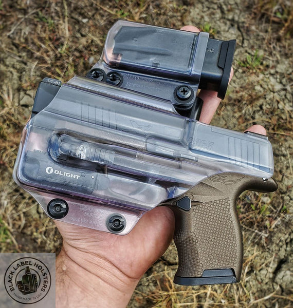"Sig Sauer P365XL with Icarus Precision ACE 365 grip module, O-Light PL-Mini 2 in our P365-length AIWB Rig holster done in Phantom Clear material.  Also shown is our tuckable single magazine carrier also done in .080"" Phantom Clear material."