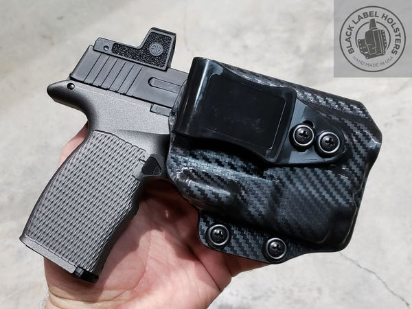 "Sig P365XL w/ Icarus Precision XL Hybrid Pro grip module, O-Light Baldr Mini in our AIWB Rig done in .080"" Black Carbon Fiber Kydex."