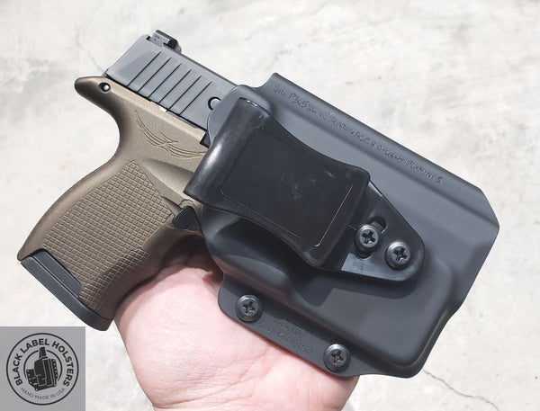 "Sig Sauer P365 with Icarus Precision ACE 365 grip module and an O-Light PL-Mini 2 weapon light in our P365XL-length AIWB Rig done in .080"" Black Kydex.  Simple, elegant and classy, not to mention reliable and affordable!"