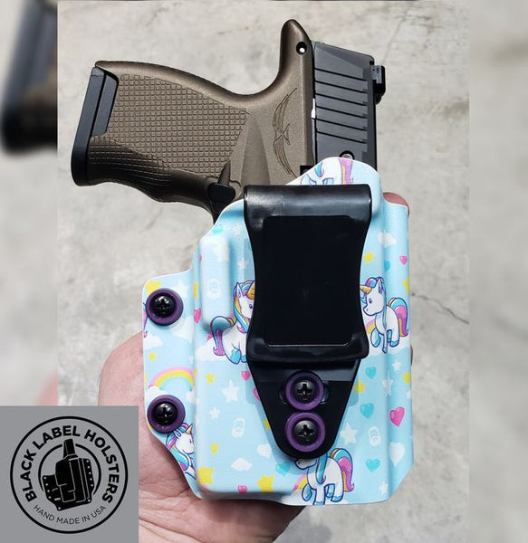 "Sig Sauer P365 with Icarus Precision 365 ACE grip module with an O-Light PL-Mini 2 in our P365XL-length AIWB Rig holster done in .080"" Blue Unicorn material.  Accepts suppressor sights, slide-mounted sights, threaded barrels and manual safety lever if equipped."