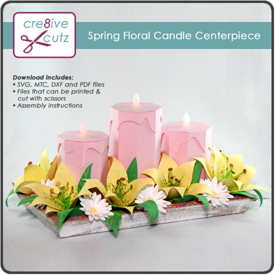 3D paper centerpiece with candles and flowers.