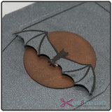 Close-up of vampire bat and moon on 3D paper coffin