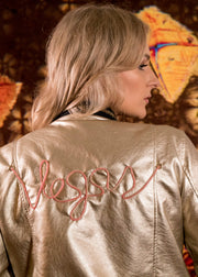 Women's gold vegan leather bomber jacket with a vegas light up design