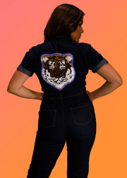 Double-sided sequin tiger that lights up on a women's denim jumpsuit