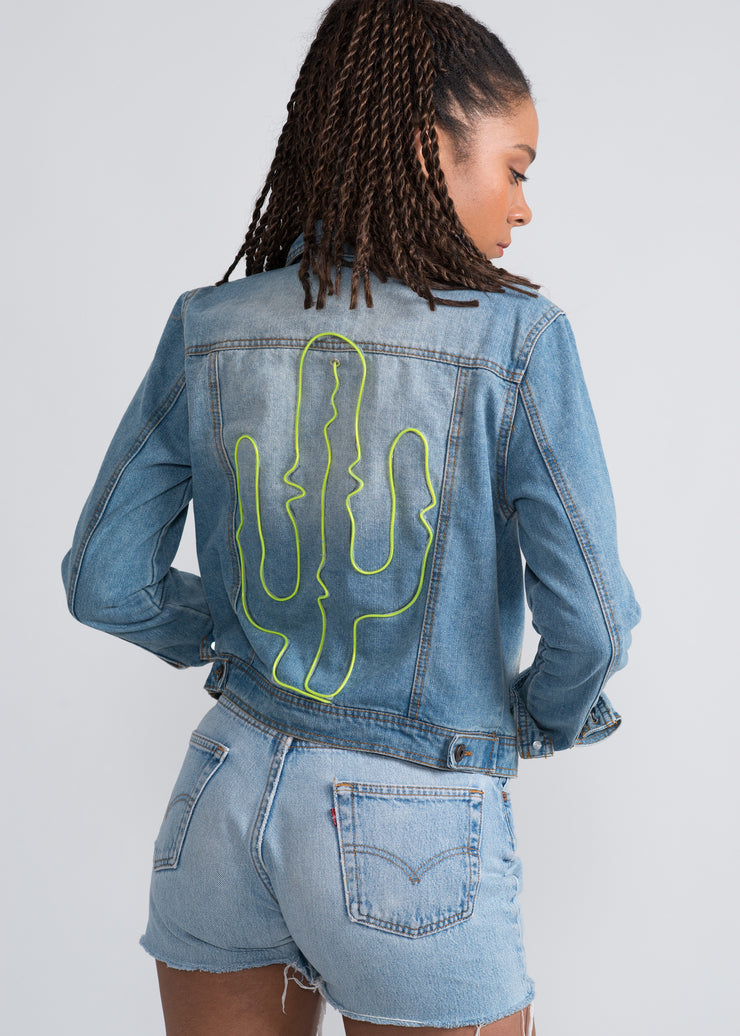 Neon cactus design off on a women's denim jacket
