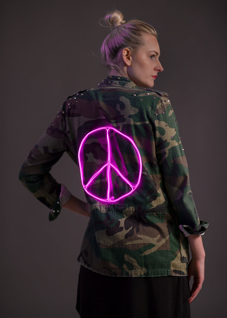 Light-up peace sign on a unisex camo jacket