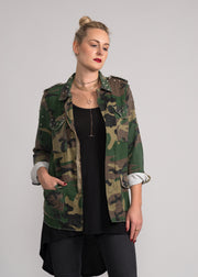 studded camo jacket for women with a light up peace sign  on back