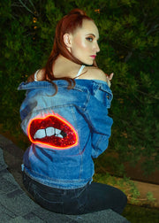 Sequin lips that light up on a women's denim jacket