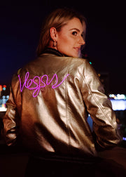Neon light up vegas design on a women's gold bomber jacket