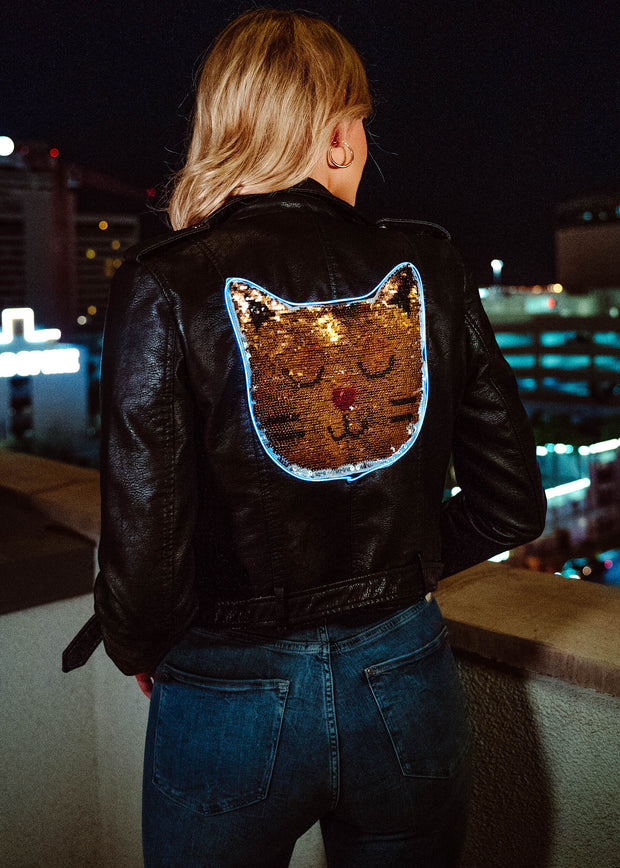 Neon cat jacket for human that lights up on a vegan leather moto