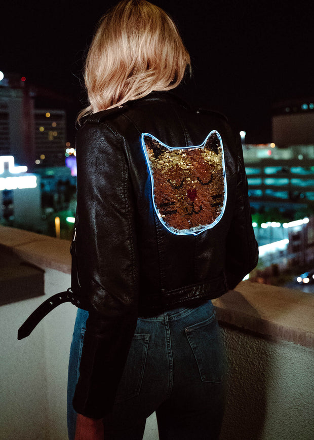 Light-up double sided sequin cat on a women's vegan leather motorcycle jacket