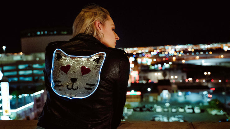 Closeup of light up sequin cat jacket for human