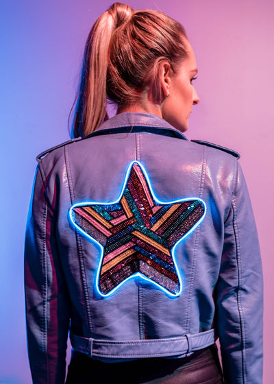 Light up sequin star design on a pastel blue vegan leather motorcycle jacket