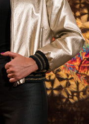 closeup vegas gold bomber jacket with black and gold sleeves