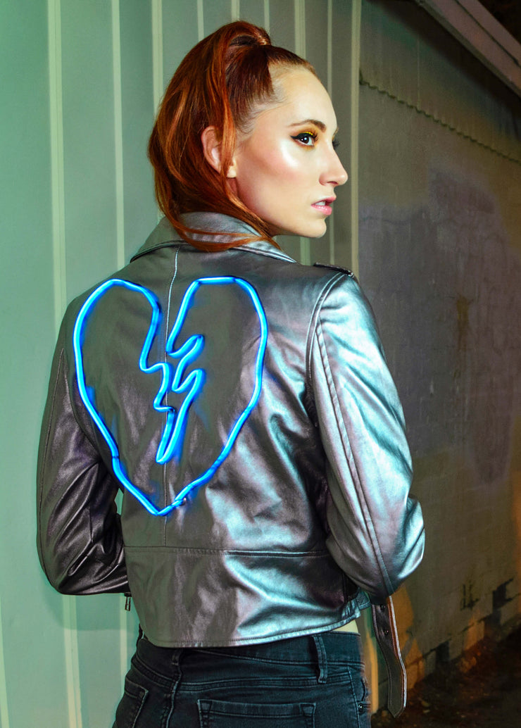 Light up broken heart design on a women's metallic vegan leather moto