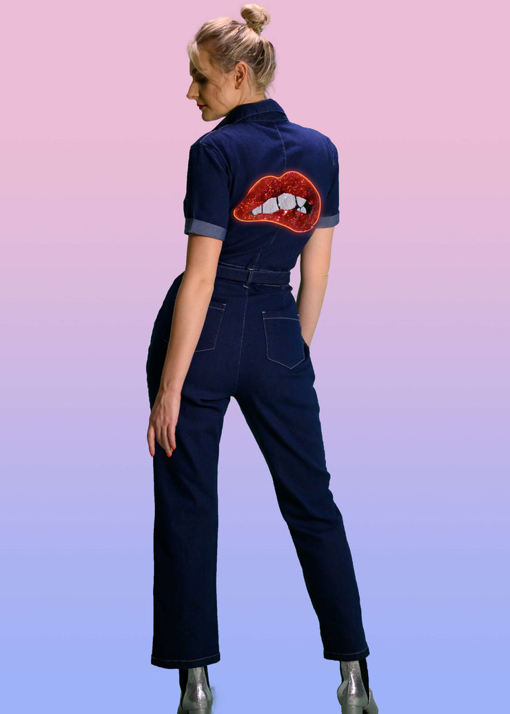 Women's soft denim jumpsuit with light up neon sequin lips on the back