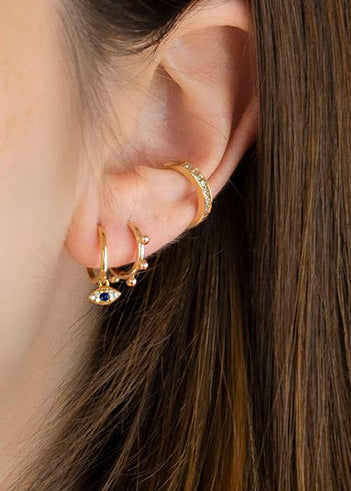 Evil eye huggie earrings in gold