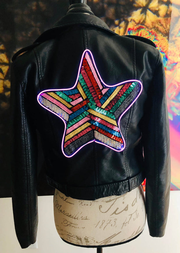 Sequin star light up design on a women's black vegas leather motorcycle jacket