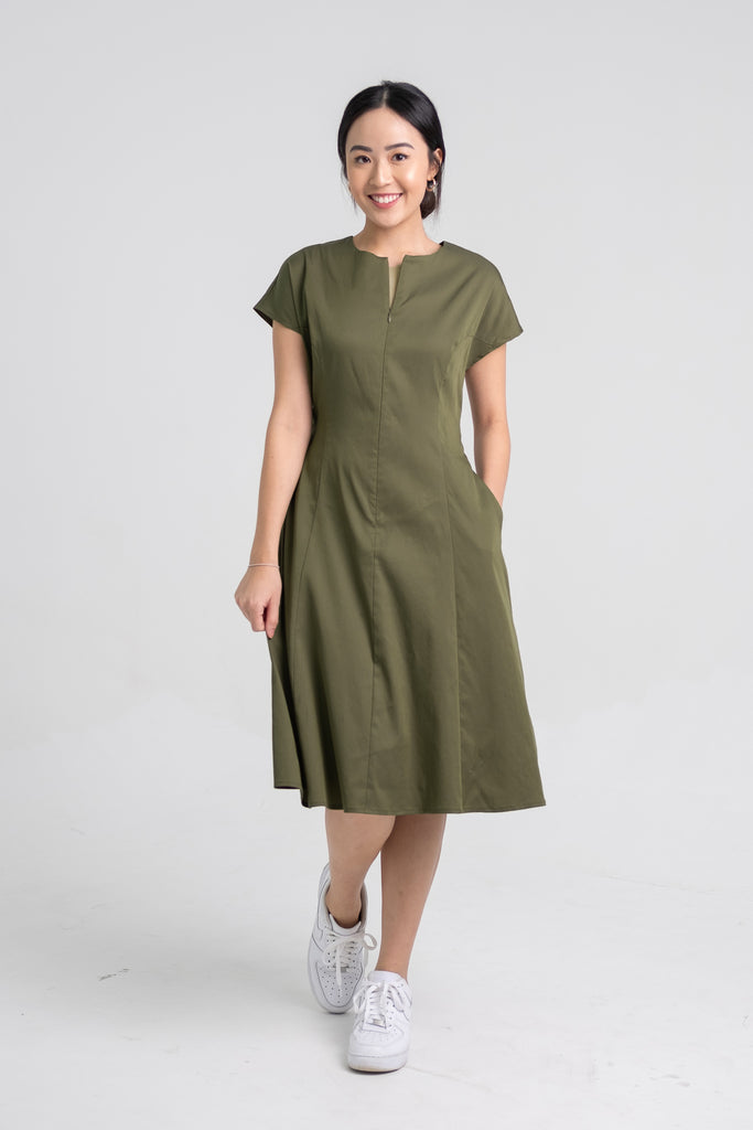 Wei Ching wearing the Midi Cap Sleeve Dress in Olive Green.