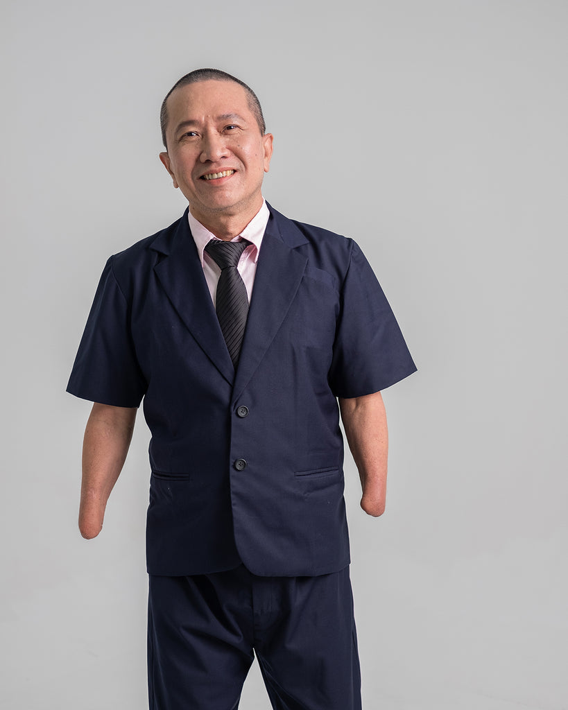 Whee Boon in his blue customised short sleeve suit jacket