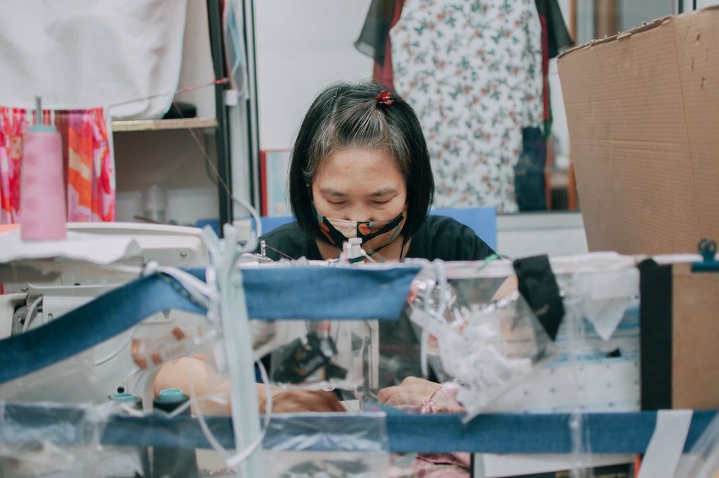 An employee at work in front of the sewing machine
