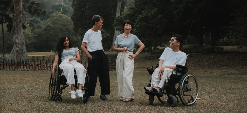 From left, Zora, Ah Gong, Ah Ma and KC, laughing together as they pose.
