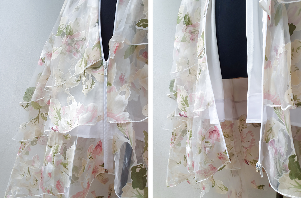 Translucent and layered white dress with floral patterns. Redesigned with open-ended zippers added.