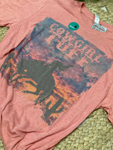 Coral tri-blend short-sleeve crew-neck tee with Cowgirl Tuff® sunset buckin' horse graphic