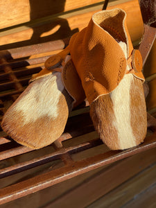 Tan cowhide baby booties