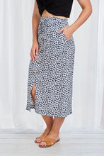 FLORAL BUTTON THROUGH MIDI SKIRT